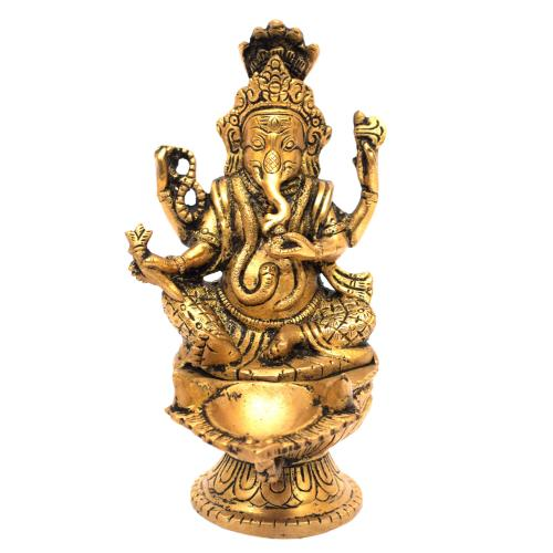 BRASS GANESHA SITTING ON DIYA