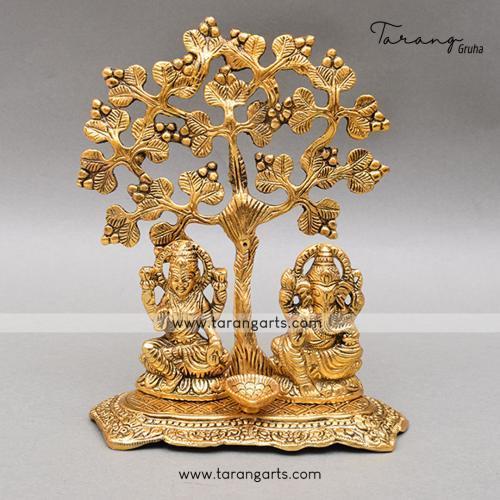 GANESHA LAKSHMI SITTNG UNDER TREE WITH DIYA